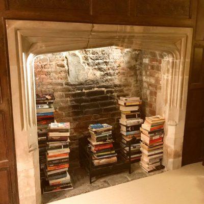 Fireplace of books, Pittleworth Manor, Hampshire